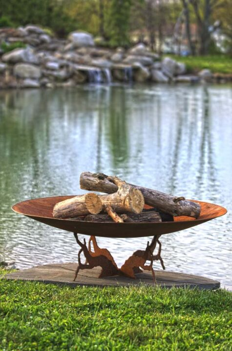 earth and sky firepit with logs