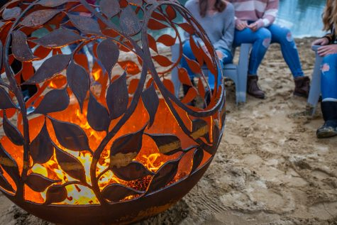 eden firepit on the sand by the water